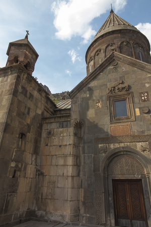 The ancient Christian temple Geghard in the mountains of Armenia