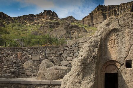 A cross carved in a rock, the Geghard monastery in Armenia