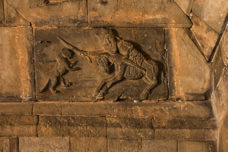 Noravank Monastery in Armenia. Relief on the wall of St. George fighting the dragon