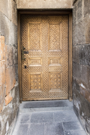Old door in the Armenian monastery Echmiadzin in Wagharashapat, Armenia Stock Photo