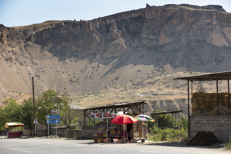 Areni, Armenia, September 18, 2017: Sales of fruit, juice and wine along roads in the area of the oldest wine cellar in the village of Areni, Armenia Editorial