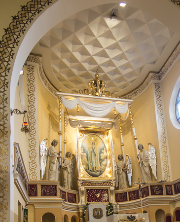 Turza Slaska, Poland, 07 October 2017: Presbytery with an altar and a painting of Our Lady of Fatima from the main altar in the Sanctuary in Turza Slaska in Poland, the first church in Poland dedicated to Our Lady of Fatima Editorial