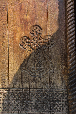 A fragment of an old wooden door in the monastery of Armenia Zdjęcie Seryjne