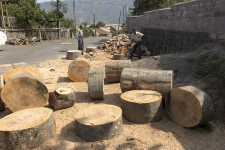 Sanahin, Armenia, September 20, 2017: Preparing wood for fuel, cutting and chopping of large blocks of wood