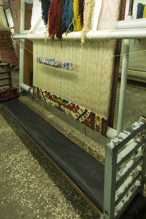 workshop for the production of rugs with a carpet started Stock Photo