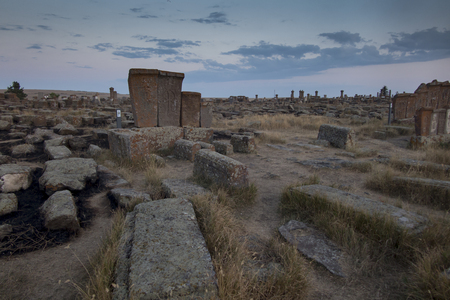 Historical cemetery of Noratus in Armenia, near the Lake Sevan, with ancient tombstones known as Khachkars. Stok Fotoğraf