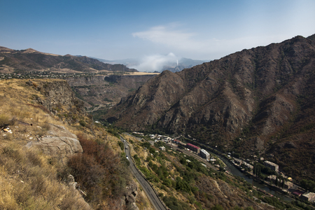 Mountain panorama from the area of Alaverdi in Armenia, behind the smoky canal on the mountain slope replacing the chimney of the Alaverdi copper factory.