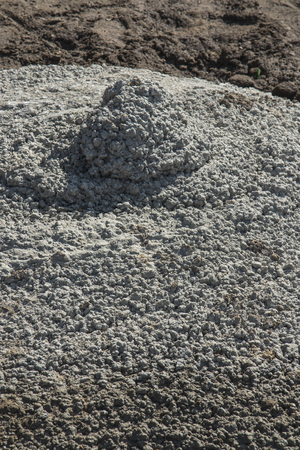 hardened concrete poured out of the cement mixer without splitting and shaking as a background