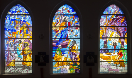 Ozarowice, Poland, 22 April 2018: Colorful stained glass windows in the windows of the church in Ozarowicach in Silesia in Poland