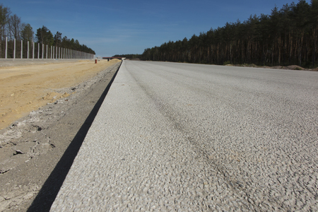 Paved surface of a new unused highway as a backdrop Stok Fotoğraf