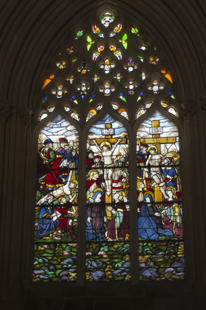 Batalha, Portugal - June 13, 2018: (vitrage window) - crucifixion icon in famous Batalha Dominican medieval monastery Portugal - great masterpieces of Gothic art. UNESCO World Heritage Editoriali