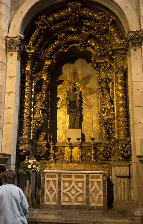 Porto, Portugal, June 15, 2018: Interior of the Porto Cathedral, one of the altars with the statue of the Virgin Mary and Jesus Editöryel