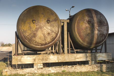 old rusty industrial tanks remaining after technological installation