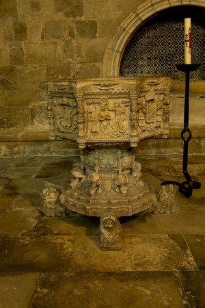Coimbra, Portugal, June 11, 2018: Interior of the Old Cathedral of Coimbra, (Se Velha de Coimbra).  Old baptismal Redakční