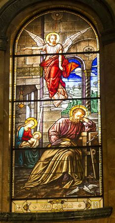 Turin, Italy, 27 June 2019: Interior of the Sanctuary of Mary Help of Christians of the Faithful in Turin, Italy. Colorful stained glass windows