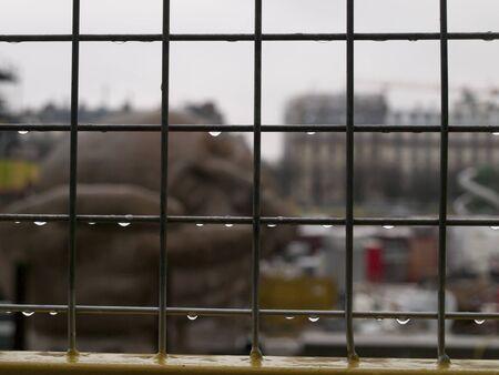 "Sculpture ""l'ecoute"" near Saint-eustache church in Paris during renovation in rainy weather, France"