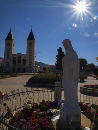 church and statue of Madonna in Medjugorje, a place of pilgrimage from all over the world in Bosnia and Hercegowinie 写真素材