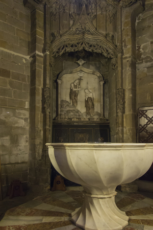 Barcelona, Spain, June 22, 2019: Interior of the Cathedral of Saint Eulalia in Barcelona - baptismal font. One of the most valuable examples of Gothic architecture in Spain.