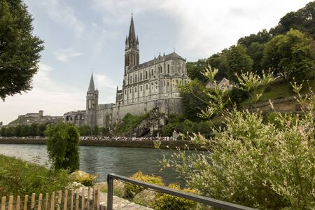 View of the Basilica of Lourdes in France with lots of pilgrims