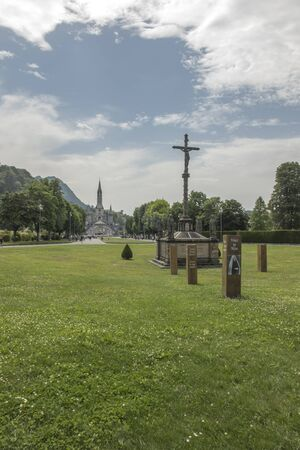 Sanctuary of our Lady of Lourdes (south-western France). View of the Basilica of our Lady of the Rosary and the square. In the foreground, the Breton Calvary.