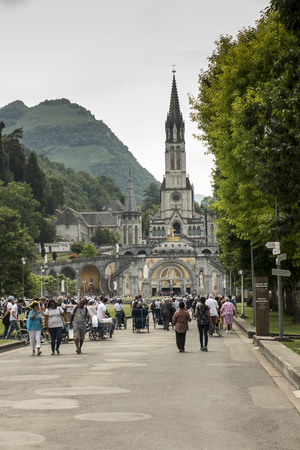 Lourdes, France June 24, 2019: Volunteers helping the sick get to the sanctuary of Our Lady in Lourdes, famous for many healings.