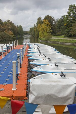 A temporary marina and moored boats on a pond in the Silesian Park in Chorzów in Poland