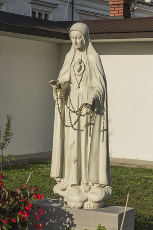 Chelm, Poland, September 14, 2019: Shrine, the Basilica of the Virgin Mary in Chelm in eastern Poland near Lublin. Rosarium or rosary garden with statues of the Mother of God