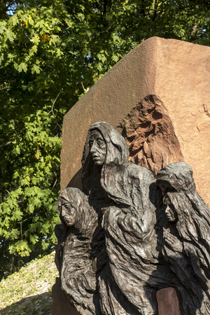 Chelm, Poland, 14 September 2019: Calvary around the Basilica of the Blessed Virgin Mary in Chelm, sculpture by Jacek Kicinski - fragment station 8, Jesus meets the women of Jerusalem. Shrine of Our Lady