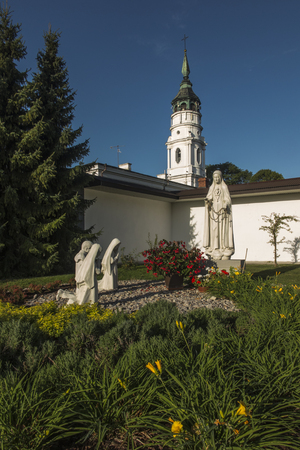 Chelm, Poland, September 14, 2019: Shrine, the Basilica of the Virgin Mary in Chelm in eastern Poland near Lublin. Rosarium or rosary garden with statues of the Mother of God and children Editöryel