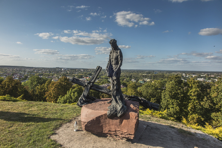 Chelm, Poland, 14 September 2019: Calvary around the Basilica of the Blessed Virgin Mary in Chelm, sculpture by Jacek Kiciński - station X, Jesus stripped of his garments. Shrine of Our Lady in Chelm