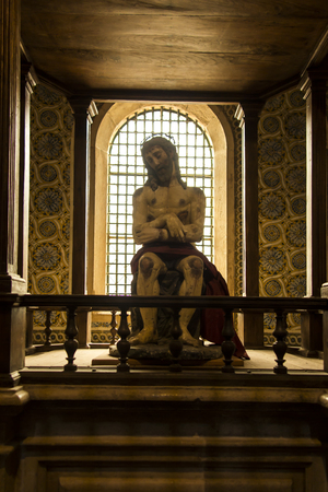 Tomar, Portugal, June 11, 2018: Sculpture of martyred Jesus from the medieval church of the Knights Templar in Tomar, Portugal
