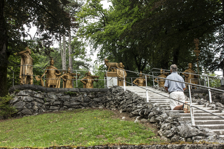 Lourdes, France, June 24 2019: Way of the Cross of Jesus. Holy stairs to get up on your knees.