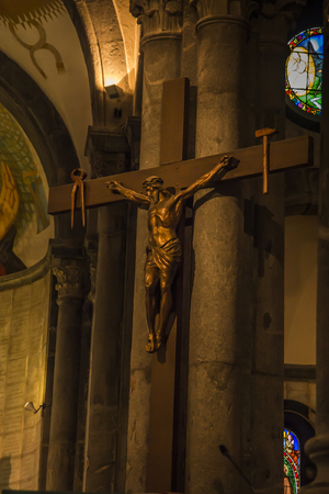 La Salette, France, June 26, 2019: Sanctuary of the Mother of God Weeping in the French Alps. Christ on the cross inside the church near the presbytery.