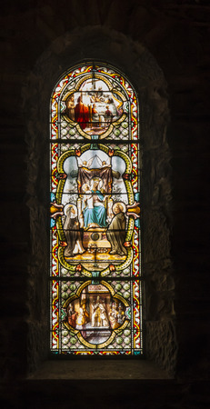 La Salette, France, 26.June 2019: Colorful stained glass window in the Sanctuary of the Weeping Virgin of La Sallette in the French Alps Publikacyjne