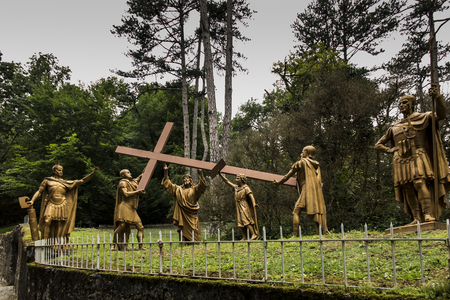 Lourdes, France, June 24 2019: Way of the Cross of Jesus, fragment 2 station - Jesus takes the cross on his shoulders