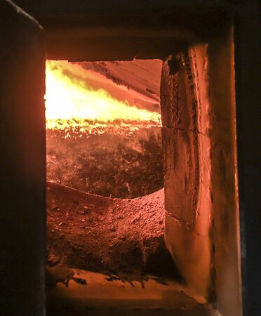fire in the boiler furnace grate the view through the hatch