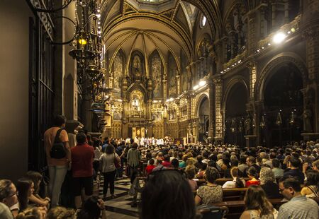 Montserrat, Spain, June 23, 2019: Interior of the Basilica of Montserrat in Spain with the statue of the Black Madonna during the liturgy