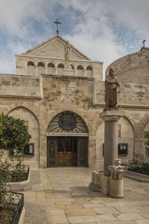 City of Bethlehem. The church Catherine next to the Basilica of the Nativity of Jesus Christ. Column with the figure of Saint Jerome (Hieronymus).