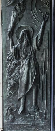 One part of the decorative door to the Stella Maris Basilica in Haifa, Israel depicts Elijah, the other depicts Mary with Jesus and the Carmelite Scapular