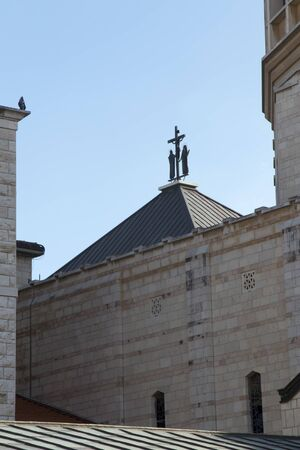 Cross on the roof near the dome of the Basilica of the Annunciation in Nazareth, Israel