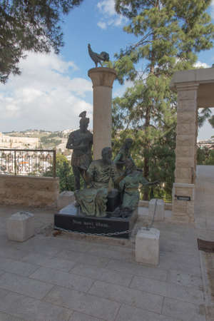 Sculptural group with the apostle Peter in the center in courtyard of the Church of St. Peter in Gallicantu in Jerusalem, Israel. Inscription: Do not even know him!