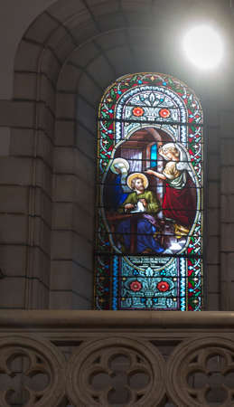 BETHLEHEM, Palestine, January 28, 2020: Colorful stained glass window in Carmelite convent on the Hill of David in Bethlehem. In the monastery church there is a reliquary with the relics of the holy Baouardy Miriam, Mary of Jesus Crucified, the Little Ara