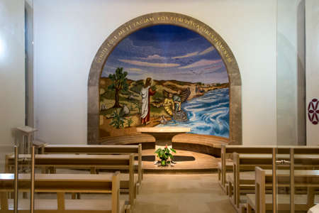 Magdala, Israel, January 26, 2020: Side altar in the church in Magdala on the Galilee Lake (Tiberiacn) with a mosaic depicting Jesus walking on the lake with the inscription: Lord, save me. Why did you doubt little faith? Banque d'images - 150899324