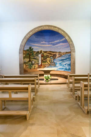 Magdala, Israel, January 26, 2020: Side altar in the church in Magdala on the Galilee Lake (Tiberiacn) with a mosaic depicting Jesus walking on the lake with the inscription: Lord, save me. Why did you doubt little faith? Banque d'images - 150899327