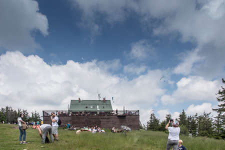 Skrzyczne, Poland, July 04, 2020: Peak, with a tourist hostel, meteorological station and telephony tower and chair lift station in Beskid Slaski Mountains (Poland)
