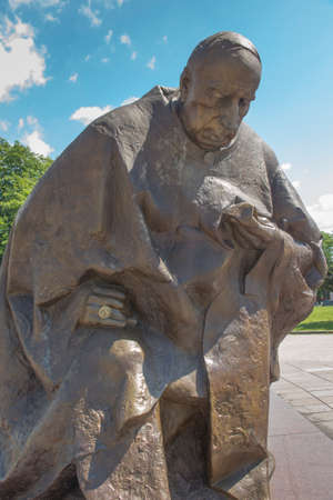 Czestochowa, Poland June 23, 2020: Monument to Cardinal Stefan Wyszynski kneeling in front of the Marian Shrine at Jasna Gora in CzÄ™stochowa. On the hand a ring with the image of Mary.