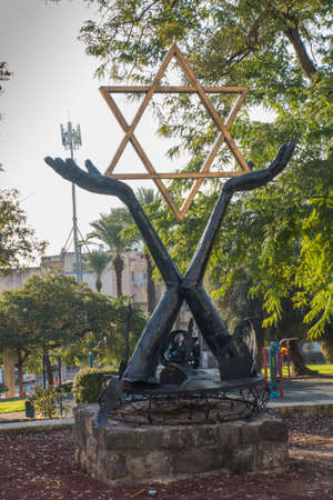 Tiberias, Israel, January 26, 2020: Monument with the Star of David in the square in the city of Tiberias on the Sea of Galilee, Israel,