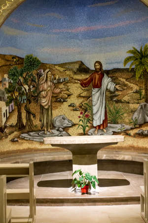 Magdala, Israel, January 26, 2020: Side altar in the church in Magdala on the Galilee Lake (Tiberiacn) with a mosaic depicting Jesus and Mary Magdalene who was left by seven evil spirits