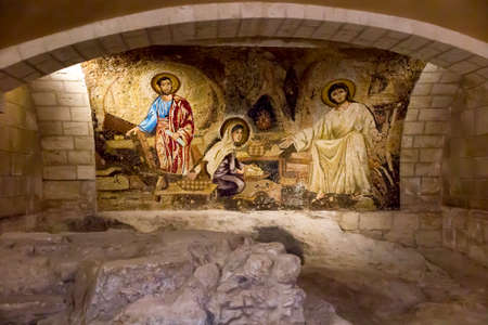 Nazareth, Israel. January 26, 2020: Hall in the dungeon under the St. Joseph's Church wall in the old city of Nazareth in Israel, Mosaic depicting the Holy Family Editorial