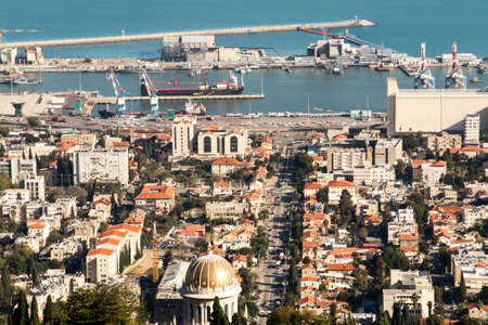 View of Haifa from the hill. Partly visible gardens of the Bahai (Shrine of the Bab), a holy pilgrimage for the Bahai believers built on Mount Carmel in Haifa, Israel.